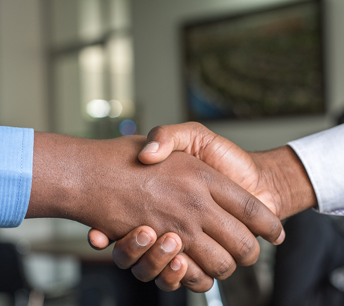 Image of two hands in a standard business handshake