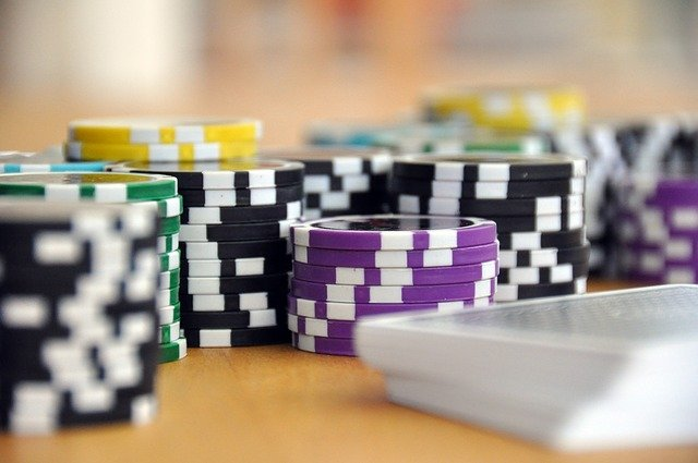 Close up of stacks of multi-coloured poker chips