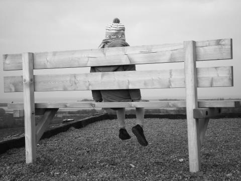 picture of child sitting on bench